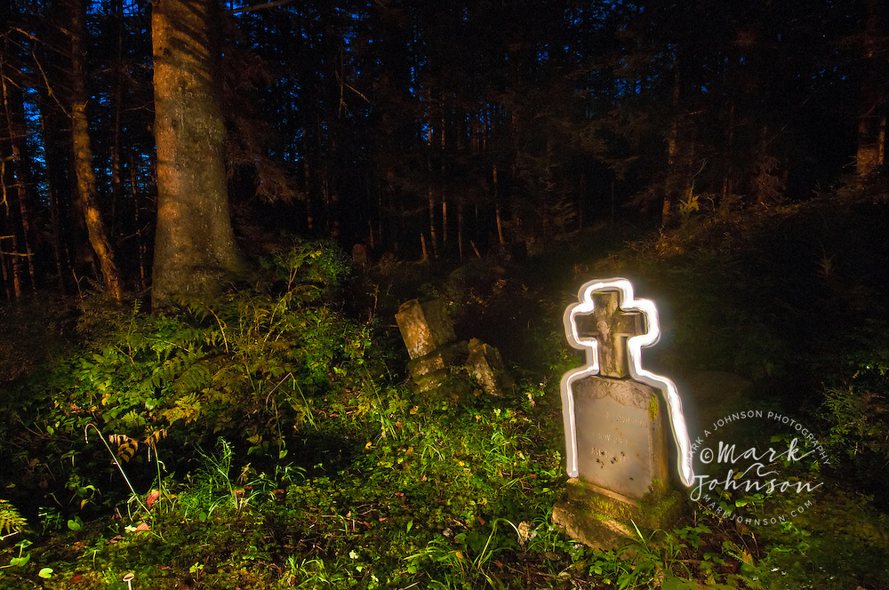Headstone with halo of light, Cemetary at night, Sitka, Alaska