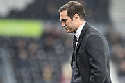 Derby County manager Frank Lampard looks dejected as the rain falls during the EFL Sky Bet Championship match between Derby County and Wigan Athletic at the Pride Park, Derby, England on 5 March 2019.