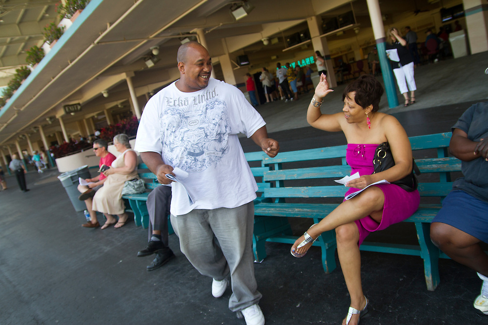 Eric Smith is congratulated by Sabrina DeLoach after he picked a winner during the ninth race of a Wednesday matinee. Derby Lane in St. Petersburg has Greyhound racing every evening Monday through Saturday and has matinee racing on Wednesdays and Saturdays..Photo by James Branaman