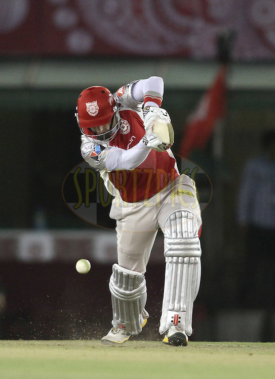Kins XI Punjab captain David Hussey drives a delivery during match 25 of the the Indian Premier League (IPL) 2012  between The Kings X1 Punjab and The Royal Challengers Bangalore India held at the Punjab Cricket Association Stadium, Mohali on the 20th April 2012..Photo by Shaun Roy/IPL/SPORTZPICS