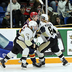 TRENTON, - Mar 25, 2016 -  Ontario Junior Hockey League game action between Trenton Golden Hawks and Wellington Dukes . Game 5 of the semi final playoff series. at the Duncan Memorial Gardens, ON. Liam Morgan #8 of the Trenton Golden Hawks and Brandon Marinelli #7 of the Trenton Golden Hawks makes the hit on Ben Sokay #24 of the Wellington Dukes<br /> (Photo by Ed McPherson / OJHL Images)