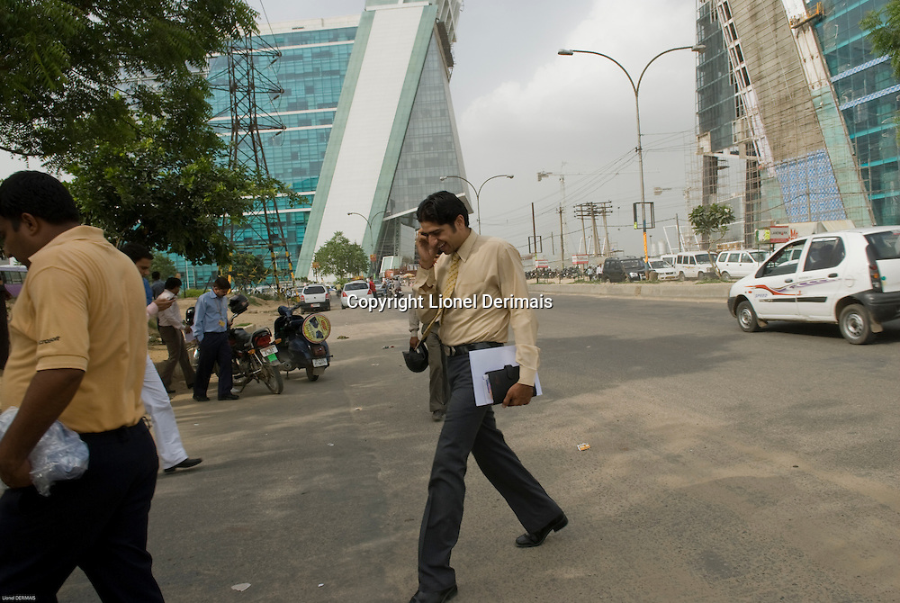 Young Indian executive on the phone in Gurgaon, New Delhi's CBD.