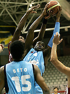 (Lugo, Spain - October 9, 2009) - CB Breogan beat league favorites, CAI Zaragoza, 72-63 in their home opener October at the Pazo dos Deportes in Lugo. Breogan forward Jeff Adrien fights for a rebound in the first half. After five games Jeff is averaging 11.4 points and 8.8 rebounds per game and leads his team in rebounds. ..Photo by Will Nunnally / Will Nunnally Photography