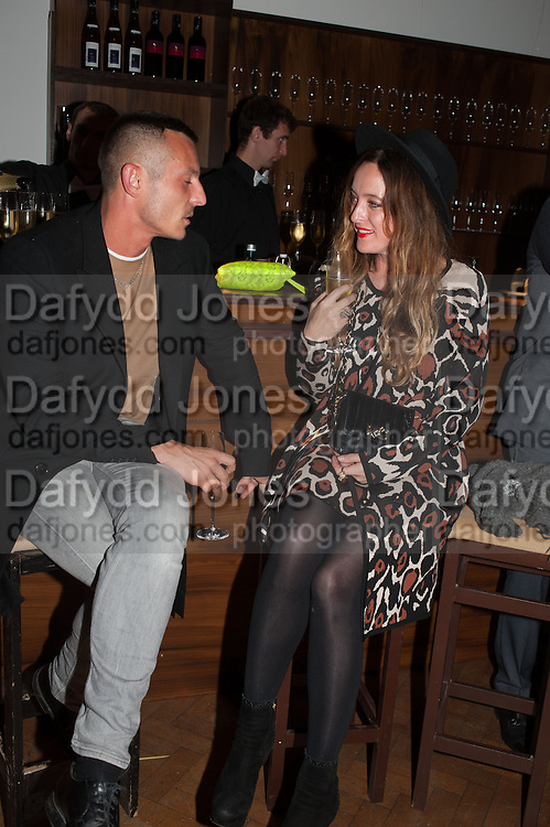 Jonathan Saunders; Alice Temperley, DINNER TO CELEBRATE THE ARTISTS OF FRIEZE PROJECTS AND THE EMDASH AWARD 2012 hosted by ANDREA DIBELIUS founder EMDASH FOUNDATION, AMANDA SHARP and MATTHEW SLOTOVER founders FRIEZE. THE FORMER CENTRAL ST MARTIN'S SCHOOL OF ART AND DESIGN, SOUTHAMPTON ROW, LONDON WC1. 11 October 2012
