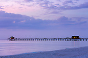 Moody sunset by the pier at Naples beach in Florida, United States of America
