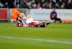 Stoke City's Charlie Adam lies injured after receiving a ball to the head - Photo mandatory by-line: Joe Meredith/JMP - Tel: Mobile: 07966 386802 07/12/2013 - SPORT - Football - Stoke-On-Trent - Britannia Stadium - Stoke City v Chelsea - Barclays Premier League