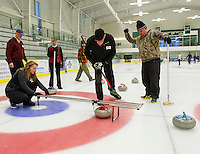 Sherry Marceau from the Madison Boulders measures their stone from the button (center) as team mate Will Brown checks the results during Thursday night's Curling League at the Plymouth State University Ice Arena. Looking on are Paul Valle, Joan Magrauth Mike Rossi and Mike Uhlman.   (Karen Bobotas/for the Laconia Daily Sun)