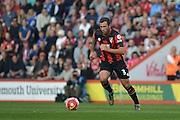 AFC Bournemouth's defender Steve Cook carries the ball out of defence during the Barclays Premier League match between Bournemouth and Watford at the Goldsands Stadium, Bournemouth, England on 3 October 2015. Photo by Mark Davies.