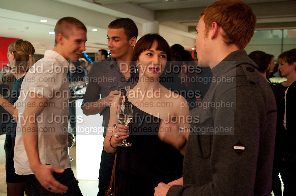 DANCERS AT THE AFTER-SHOW PARTY, FIRST NIGHT for Matthew Bourne's Swan Lake. Sadler's Wells. London. 11 December 2009