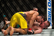 Alexandre Pantoja (Yellow Shorts) in action against Neil Seery during their flyweight bout during the UFC Fight Night at the SSE Hyrdo, Glasgow.