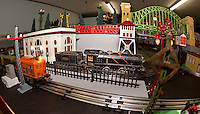 A 1920's  #248 electric train (far left) and a 1927 #262 steamer are among the many locomotives making their way around the model train extravaganza on public display in the upper level of Laconia Antiques Center on Main Street downtown.  (Karen Bobotas/for the Laconia Daily Sun)