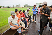 01 JULY 2006 - PHNOM PENH, CAMBODIA: Passengers on the Phnom Penh - Battambang train ride on a flat car. Passengers on the train ride where ever there is space, the passenger cars, the flat cars and the boxcars are all packed. While much of Cambodia's infrastructure has been rebuilt since the wars which tore the country apart in the late 1980s, the train system is still in disrepair. There is now only one passenger train in the country. It runs from Phnom Penh to the provincial capitol Battambang and it runs only one day a week. It takes 12 hours to complete the 190 mile journey.  Photo by Jack Kurtz / ZUMA Press