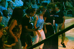 Members of the audience come down to dance in front of the stage to the rhythms of Tito Puente, Jr. and his Orchestra.  Tito Puente, Jr. and his Orchestra perform at the Reichhold Center of the Arts.  Puente's performance marks 25 years and 3 days since his father, renowned Latin jazz and salsa musician performed on this same stage for a Virgin Islands audience.  Tito Puente, Jr. nurtures his father's musical legacy by performing the classic compostions for which he was known.  throughout © Aisha-Zakiya Boyd
