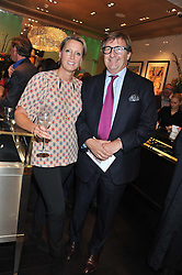 ANNOUSHKA DUCAS and JOHN AYTON at a private view of an exhibition 'Outside in Chelsea' held at Annoushka, 41 Cadogan Gardens, London SW3 on 2nd October 2012.