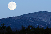 The Full Moon rises over Mayo Mountain in Jericho, Vermont.