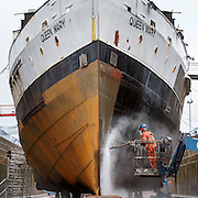 FREE PICTURES :  The Queen Mary in dry dock in Greenock.<br /> Picture Robert Perry 5th Aug 2016<br /> <br /> Please credit photo to Robert Perry<br /> <br /> Image is free to use in connection with the promotion of the above company or organisation. 'Permissions for ALL other uses need to be sought and payment make be required.<br /> <br /> <br /> Note to Editors:  This image is free to be used editorially in the promotion of the above company or organisation.  Without prejudice ALL other licences without prior consent will be deemed a breach of copyright under the 1988. Copyright Design and Patents Act  and will be subject to payment or legal action, where appropriate.<br /> www.robertperry.co.uk<br /> NB -This image is not to be distributed without the prior consent of the copyright holder.<br /> in using this image you agree to abide by terms and conditions as stated in this caption.<br /> All monies payable to Robert Perry<br /> <br /> (PLEASE DO NOT REMOVE THIS CAPTION)<br /> This image is intended for Editorial use (e.g. news). Any commercial or promotional use requires additional clearance. <br /> Copyright 2016 All rights protected.<br /> first use only<br /> contact details<br /> Robert Perry     <br /> 07702 631 477<br /> robertperryphotos@gmail.com<br />        <br /> Robert Perry reserves the right to pursue unauthorised use of this image . If you violate my intellectual property you may be liable for  damages, loss of income, and profits you derive from the use of this image.