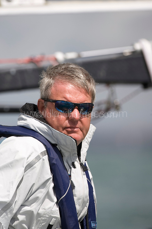 """Day two of Skandia Cowes Week 2008 (Saturday) ..iShares Cup Extreme 40 racing.  ..Sir Keith Mills, principle of """"Team Origin"""", on board the Extreme 40...Please credit all pictures """"Lloyd Images"""""""