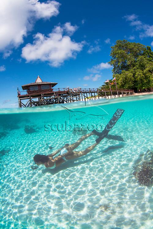 Split image of beach and free diver, Ai Futaki swimming underwater, Sipadan, Sabah, Malaysia