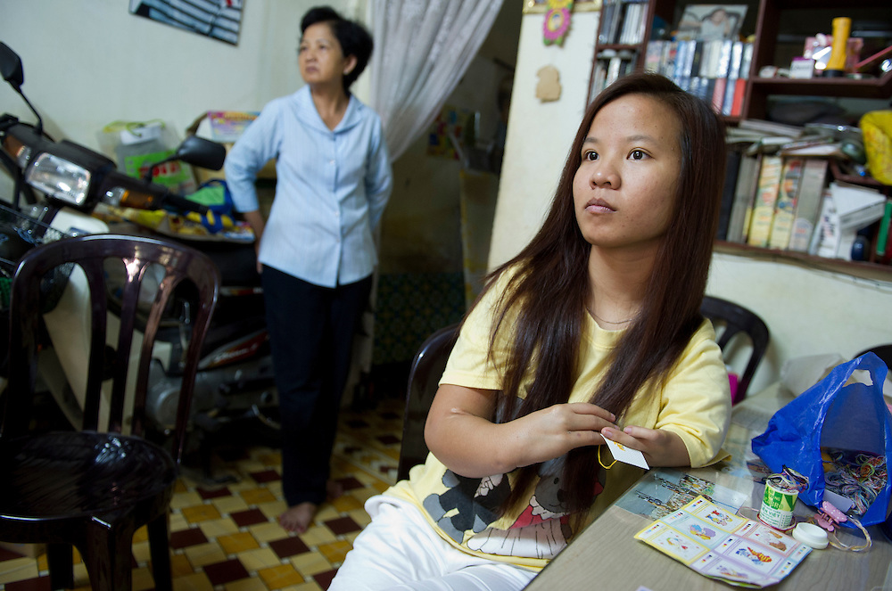 Vo Thanh Tam, 20 yrs old, with her mother,.Le Thi Kim Lan. A victim of dioxin poisoning, Tam left school because of bullying and hopes to be an artist someday.