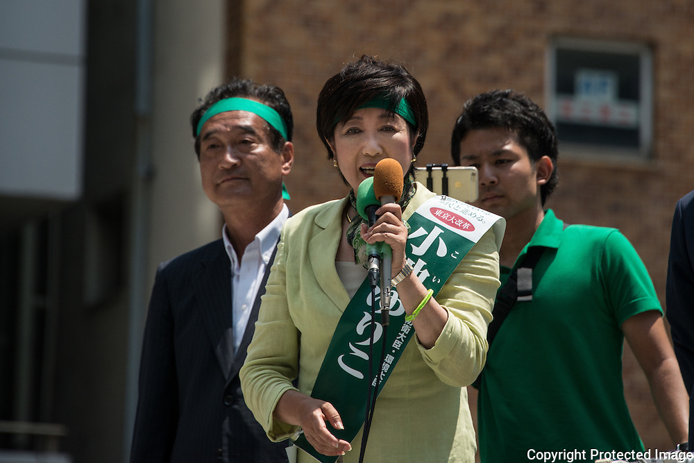 Yuriko Koike, a Liberal Democratic Party lawmaker and former defense minister deliver speech to people as she kicks off her campaign for the July 31 Tokyo gubernatorial election in front of Meguro Station, Tokyo, Japan on Friday, July 29, 2016. 29/07/2016-Tokyo, JAPAN