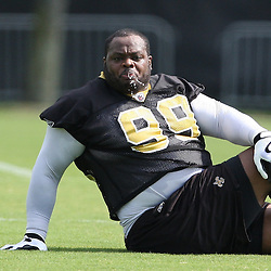 2008 May 21: New Orleans Saints defensive tackle Hollis Thomas #99 stretches during team organized activities at the Saints training facility in Metairie, LA. .