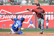 SURPRISE, AZ - MARCH 06:  Chris Owings #16 of the Arizona Diamondbacks turns the double play over Jorge Bonifacio #38 of the Kansas City Royals during the third inning of the spring training game at Surprise Stadium on March 6, 2017 in Surprise, Arizona.  (Photo by Jennifer Stewart/Getty Images)