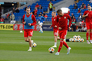 Wales forward Gareth Bale and Wales defender Chris Gunter warming up during the UEFA European 2020 Qualifier match between Wales and Azerbaijan at the Cardiff City Stadium, Cardiff, Wales on 6 September 2019.