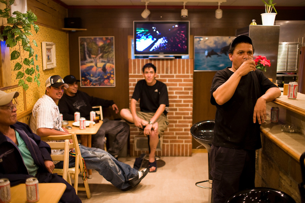 Having a drink after work in one of the  local bars built by residents ... Residents of the  Homi Danchi area of Toyota City,  Nearly all the  residents are Foreigners  with about 1/2 of them from Brazil. . Most  work at Toyota Factories or companies  of  the Toyota Group.