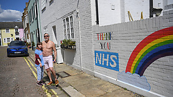 © Licensed to London News Pictures. 02/05/2020. Hammersmith, west London, UK. Nick Hamelin stands with his daughter outside his home next to a new mural that has popped up overnight. The street art expressing support for the NHS during the COVID-19 crisis, is the creation of 12 year old Alex, helped by cousin Chelsea.  Photo credit: Guilhem Baker/LNP