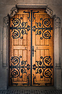 Brown wooden door with Black detail, stone surround, Croatia