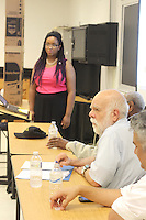 """Students were invited from around the city to display and show their history fair projects at the Lutheran School of Theology located at 1100 E. 55th Street. This event was sponsored by the Hyde Park Historical Society. <br /> <br /> 4172 – Judge, Jay Mulburry gives insight into Eva Lewis's (far left) presentation.<br /> <br /> All rights to this photo are owned by Spencer Bibbs of Spencer Bibbs Photography and may only be used in any way shape or form, whole or in part with written permission by the owner of the photo, Spencer Bibbs.<br /> <br /> For all of your photography needs, please contact Spencer Bibbs at 773-895-4744. I can also be reached in the following ways:<br /> <br /> Website – www.spbdigitalconcepts.photoshelter.com<br /> <br /> Text - Text """"Spencer Bibbs"""" to 72727<br /> <br /> Email – spencerbibbsphotography@yahoo.com"""