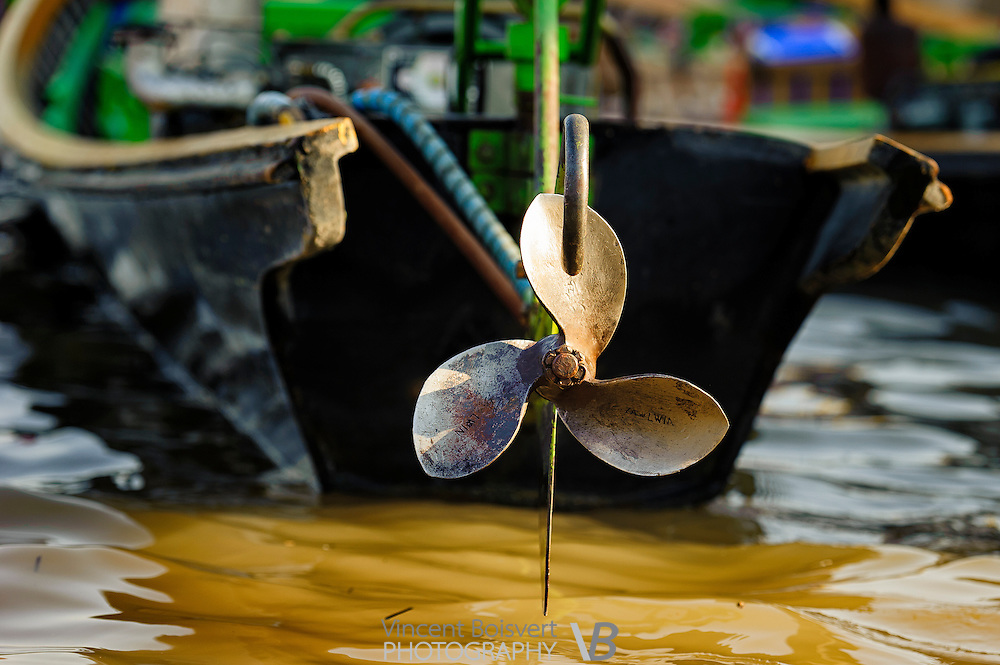 a close-up view of a propeller behind a long-boat, Inle lake, myanmar