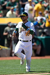 OAKLAND, CA - JUNE 21:  Ben Zobrist #18 of the Oakland Athletics scores a run against the Los Angeles Angels of Anaheim during the sixth inning at O.co Coliseum on June 21, 2015 in Oakland, California. The Oakland Athletics defeated the Los Angeles Angels of Anaheim 3-2. (Photo by Jason O. Watson/Getty Images) *** Local Caption *** Ben Zobrist