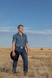 hot cowboy standing in a field