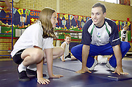 Olympic Gymnast, Daniel Keating visits his old school of Daneholme Juniors in Corby...pictured with Daniel, learning the best bunny hop position is 10 yr old, Emma Kibble
