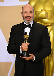 Mark Bridges with his oscar for Best Costume Design in Phantom Thread in the press room at the 90th Academy Awards held at the Dolby Theatre in Hollywood, Los Angeles, USA.PRESS ASSOCIATION Photo. Picture date: Sunday March 4, 2018. See PA Story SHOWBIZ Oscars. Photo credit should read: Ian West/PA Wire