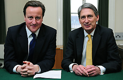 Leader of the Conservative Party David Cameron with Philip Hammond, Member of Parliament for Runnymede and Weybridge in his office in Norman Shaw South, January 7, 2010. Photo By Andrew Parsons / i-Images.