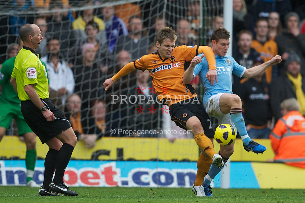 WOLVERHAMPTON, ENGLAND - Saturday, October 30, 2010: Manchester City's James Milner and Wolverhampton Wanderers' Kevin Doyle during the Premiership match at Molineux. (Pic by: David Rawcliffe/Propaganda)