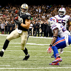 Oct 27, 2013; New Orleans, LA, USA; New Orleans Saints tight end Jimmy Graham (80) catches a touchdown past Buffalo Bills strong safety Da'Norris Searcy (25) during the first half of a game at Mercedes-Benz Superdome. Mandatory Credit: Derick E. Hingle-USA TODAY Sports