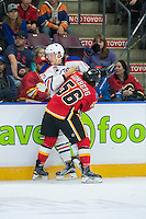 PENTICTON, CANADA - SEPTEMBER 17: Ryan Lomberg #56 of Calgary Flames checks Matt Benning #83 of Edmonton Oilers into the boards on September 17, 2016 at the South Okanagan Event Centre in Penticton, British Columbia, Canada.  (Photo by Marissa Baecker/Shoot the Breeze)  *** Local Caption *** Matt Benning; Ryan Lomberg;