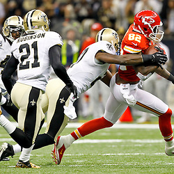 September 23, 2012; New Orleans, LA, USA; Kansas City Chiefs wide receiver Dwayne Bowe (82) breaks away from New Orleans Saints safety Malcolm Jenkins (27) during the second quarter of a game at the Mercedes-Benz Superdome. Mandatory Credit: Derick E. Hingle-US PRESSWIRE