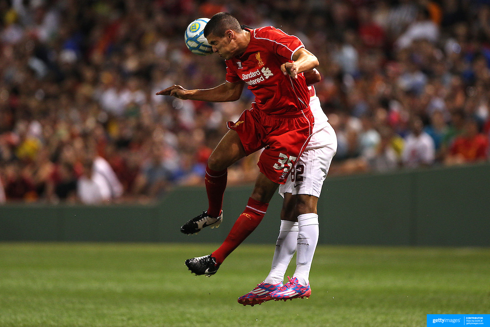 Connor Coady, Liverpool, wins a header during the Liverpool Vs AS Roma friendly pre season football match at Fenway Park, Boston. USA. 23rd July 2014. Photo Tim Clayton