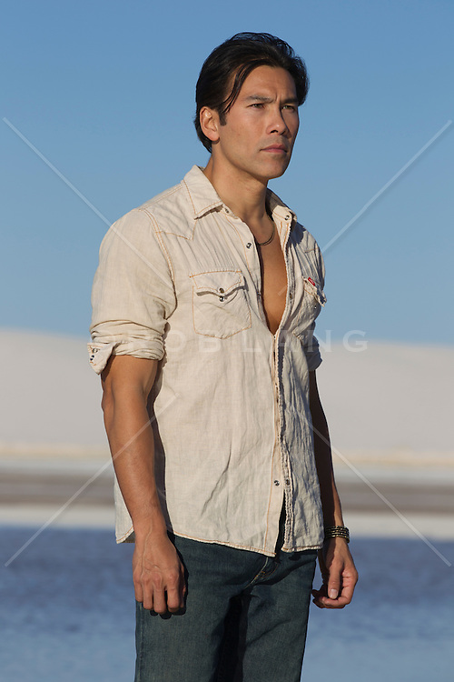 good looking Asian American man standing alone in the desert of New Mexico