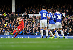 Liverpool's Steven Gerrard takes a free kick - Photo mandatory by-line: Dougie Allward/JMP - Tel: Mobile: 07966 386802 23/11/2013 - SPORT - Football - Liverpool - Merseyside derby - Goodison Park - Everton v Liverpool - Barclays Premier League