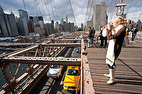 tourist on brooklyn bridge in New York City October 2008