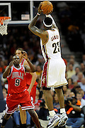 Apr 27, 2010; Cleveland, OH, USA; Cleveland Cavaliers forward LeBron James (23) shoots a long jumper in front of Chicago Bulls forward Luol Deng (9) during the third period in game five in the first round of the 2010 NBA playoffs at Quicken Loans Arena.  Mandatory Credit: Jason Miller-US PRESSWIRE