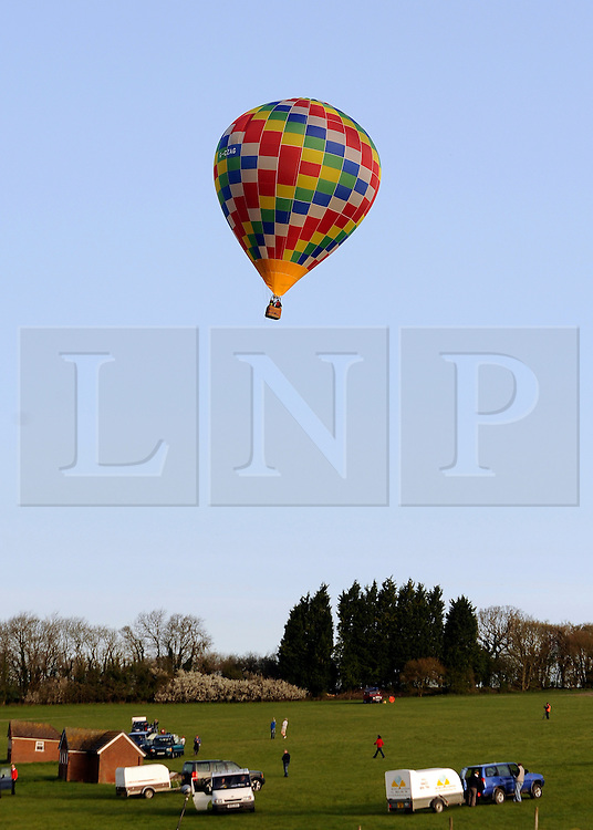 ©London News pictures. 07/04/2011. CANTERBURY: The last balloon departs. Approximately 50 hot air balloons from across the UK and Europe take advantage of the weather window and take off from Lydden Hill Race Circuit, Wootton, Kent, to fly across the English Channel marking the largest ever group of balloons to attempt the crossing. The participants  have been waiting since October for the event to happen. Picture credit should read Stephen Simpson/LNP