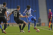 Brighton & Hove Albion defender Sam Adekugbe (44) and Milton Keynes Dons defender Callum Brittain (21) during the The FA Cup match between Brighton and Hove Albion and Milton Keynes Dons at the American Express Community Stadium, Brighton and Hove, England on 7 January 2017.