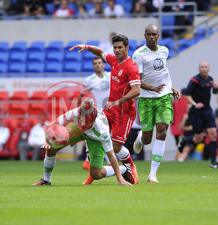 Cardiff City's Javi Guerra battles for the ball with VfL Wolfsburg's Timm Klose - Photo mandatory by-line: Joe Meredith/JMP - Mobile: 07966 386802 02/08/2014 - SPORT - FOOTBALL - Cardiff - Cardiff City Stadium - Cardiff City v VfL Wolfsburg - Pre-Season Friendly
