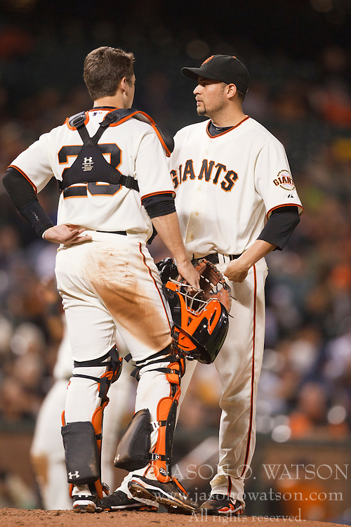 August 30, 2010; San Francisco, CA, USA;  San Francisco Giants catcher Buster Posey (28) talks with starting pitcher Jonathan Sanchez (57) during the fifth inning against the Colorado Rockies at AT&T Park.  Colorado defeated San Francisco 2-1.